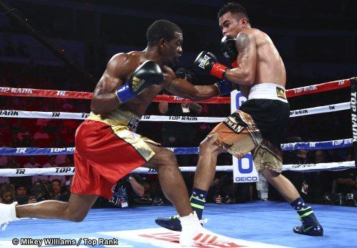 Jamel Herring (left) vs. John Vincent Moralde. Photo credit: Mikey Williams/Top Rank