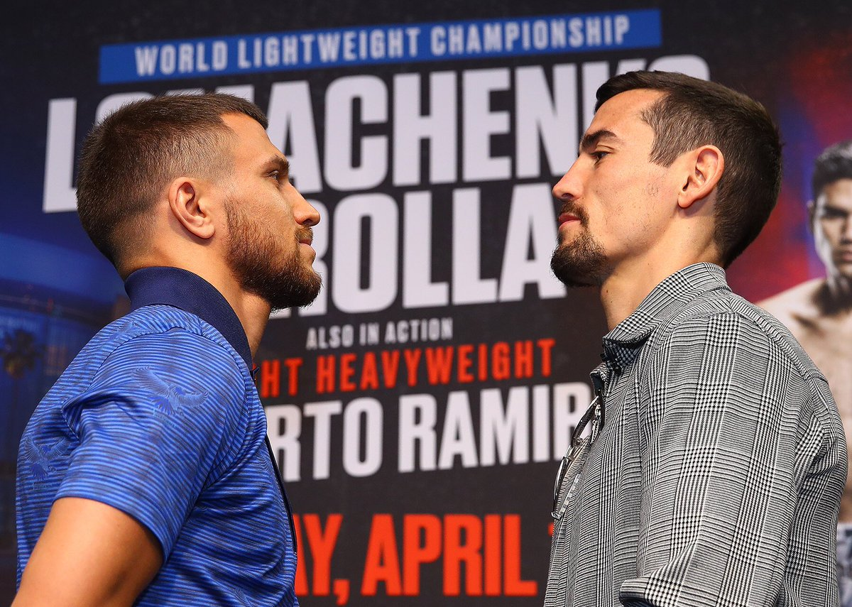 Vasiliy Lomachenko (left) and Anthony Crolla engage in a staredown following the final press conference for their April 12 lightweight championship bout. Photo by Mikey Williams/Top Rank