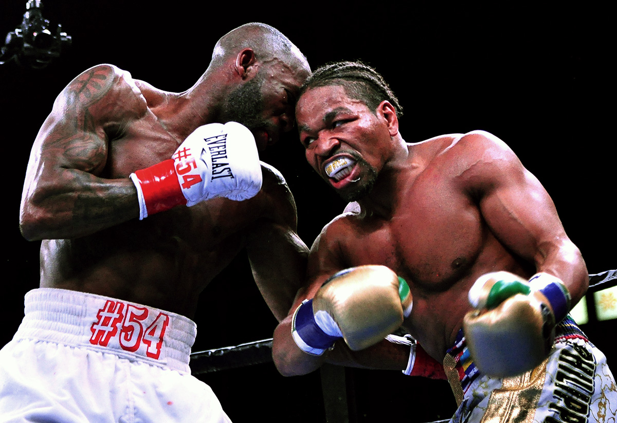 Shawn Porter (right) boxed from a distance for much of his fight against Yordenis Ugas on March 9 in Carson, California, but still utilized his trademark infighting to eke out a split-decision victory. (Photo by German Villasenor)