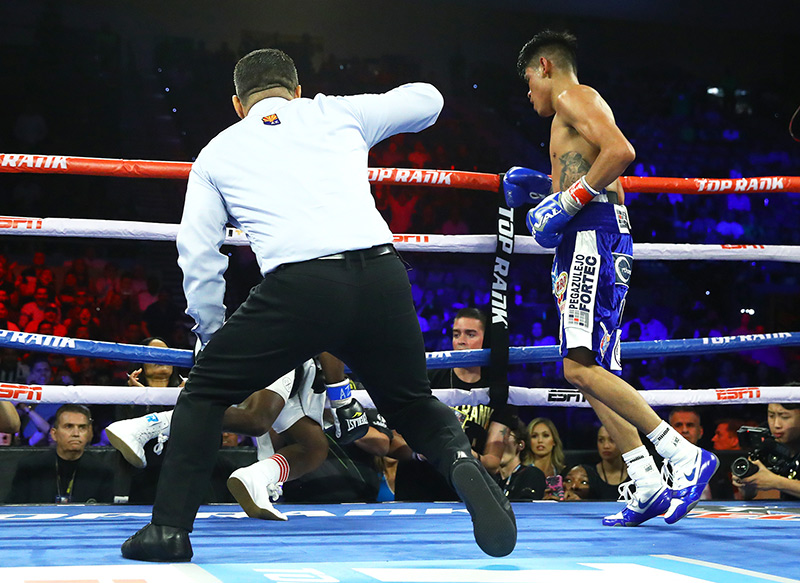 Emanuel Navarrete (standing) sends Isaac Dogboe to canvas. Photo by Mikey Williams-TOP RANK