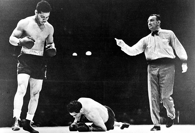 Joe Louis stands over Max Schemling Ring - The Ring Archives: Born on this day: Joe Louis – part one