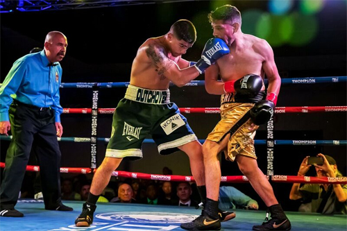 Michael Dutchover vs. Sergio Ramirez Martinez Photo credit Andrea Kaus - Michael Dutchover turns the phone off…and the focus on