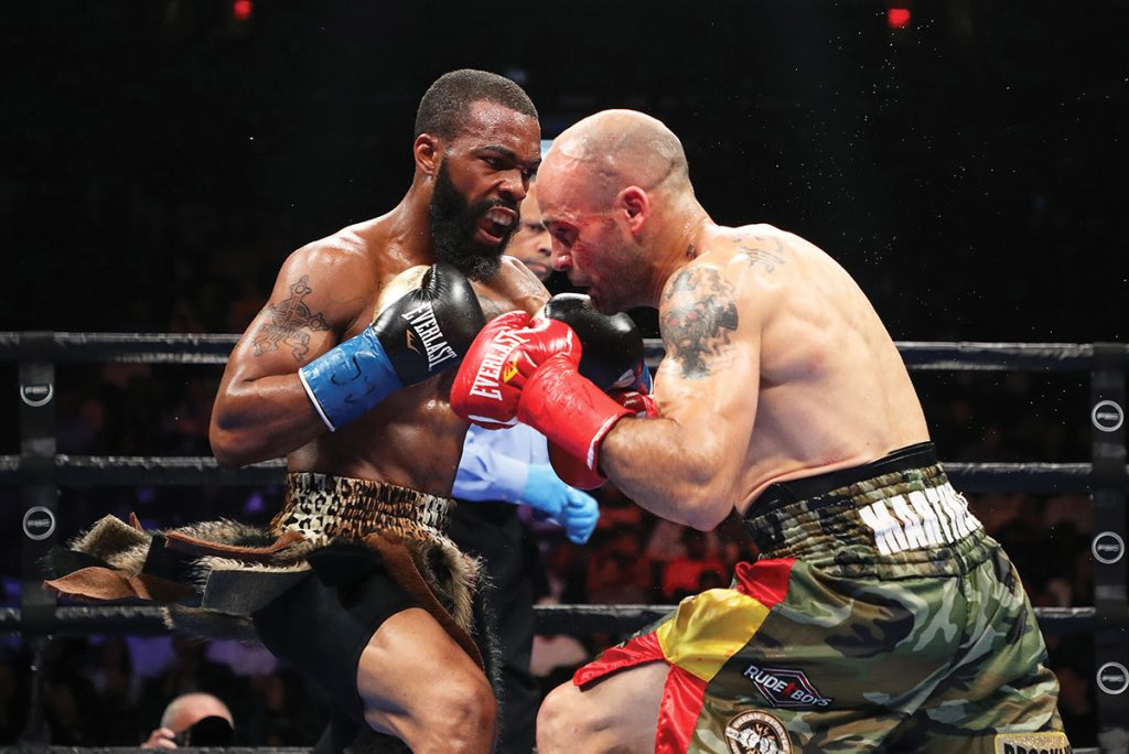 Gary Russell (left) opens up on Kiko Martinez. Photo by Al Bello/ Getty Images