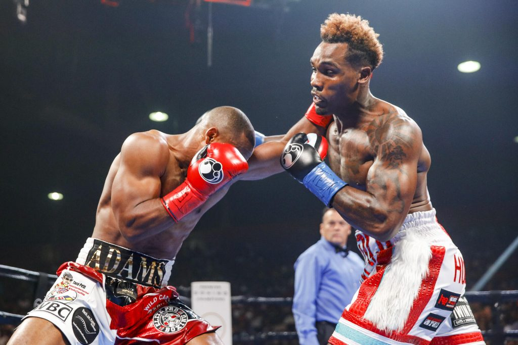 Jermall Charlo (right) nails Brandon Adams en route to his unanimous WBC middleweight title defense Saturday night. Photo by Esther Lin/Showtime