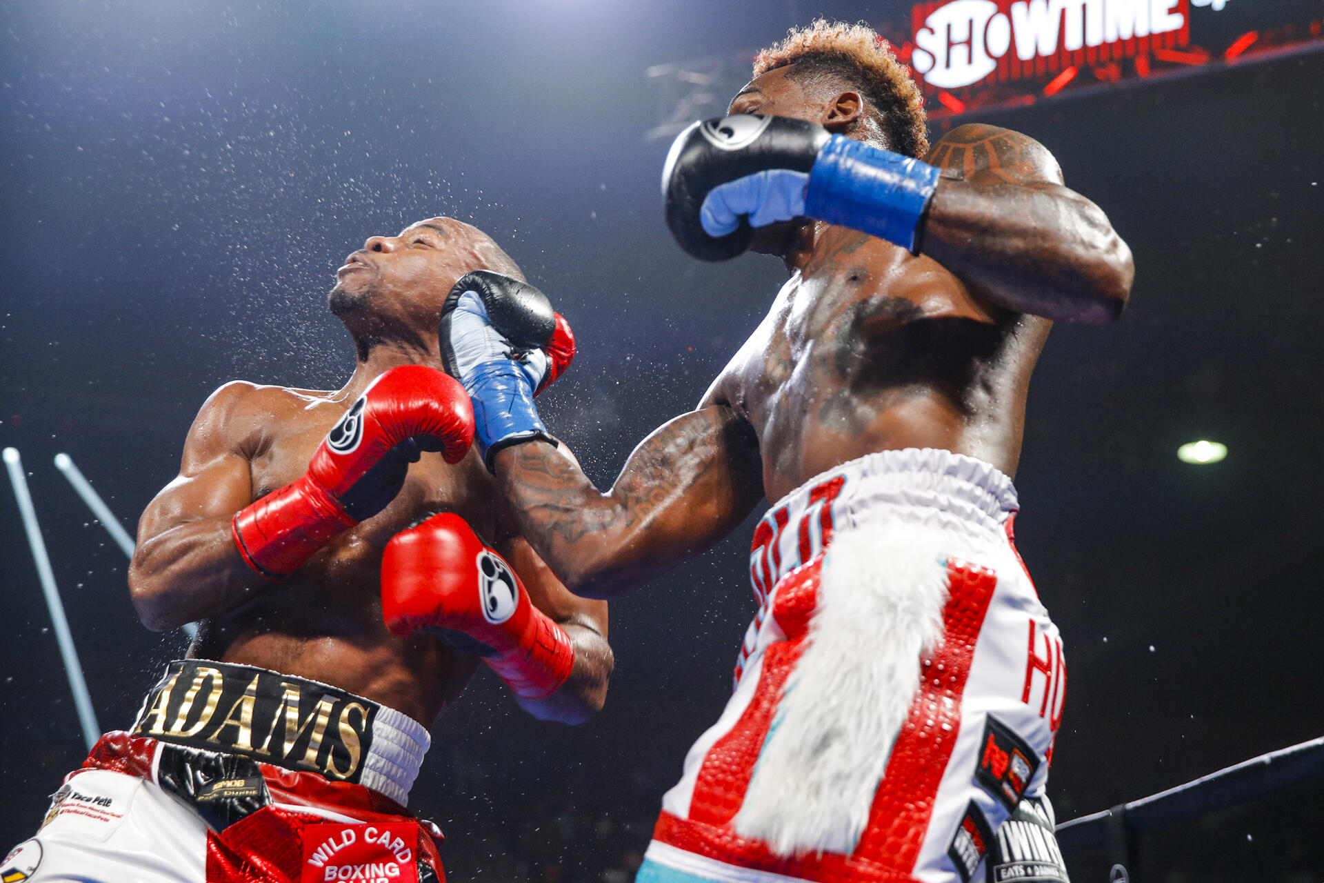 Jermall Charlo's (right) right uppercut jolted Brandon Adams more than a few times during the course of 12 rounds. Photo by Esther Lin/Showtime.