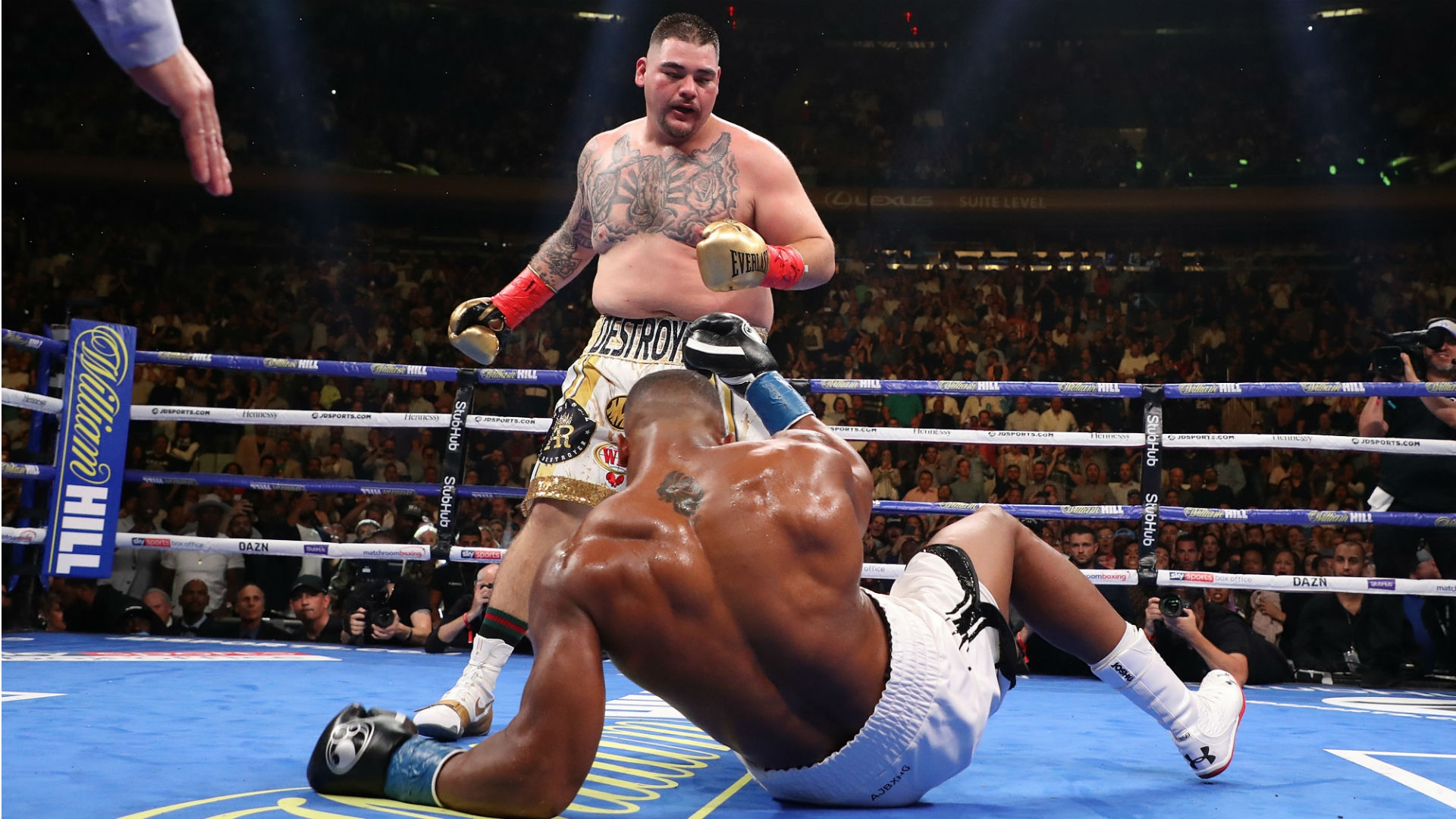 IBF/WBA/WBO heavyweight titlist Andy Ruiz (standing) vs. Anthony Joshua. Photo credit: Getty Images
