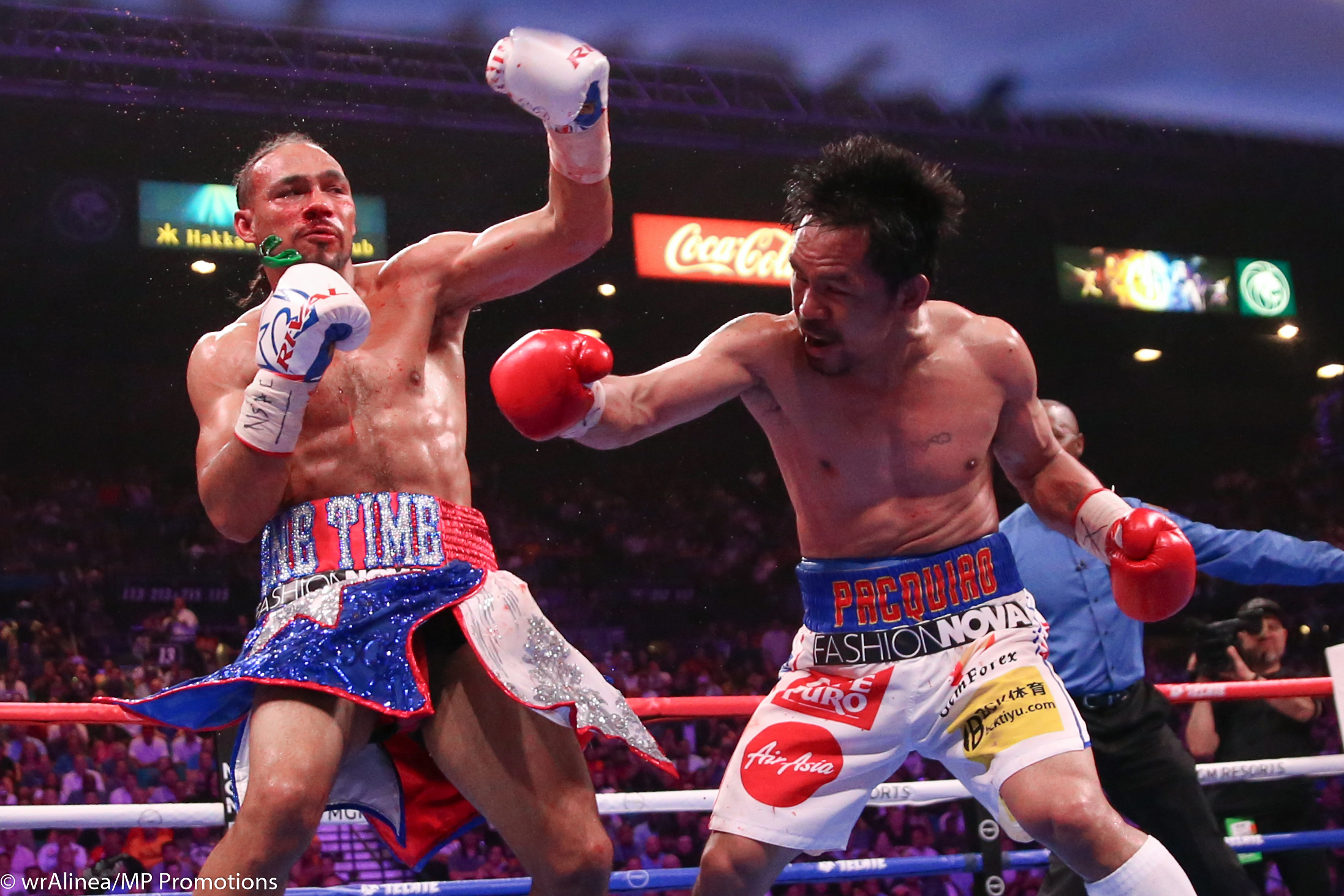 Manny Pacquiao (right) vs. Keith Thurman. Photo by Wendell Alinea/Team Pacquiao