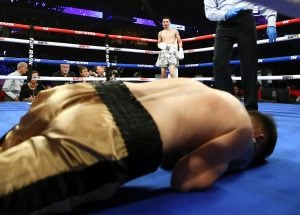 A Jeremy Adorno left to the body dropped Fernando Robles at 2:01 of the third. Photo by Mikey Williams/Top Rank