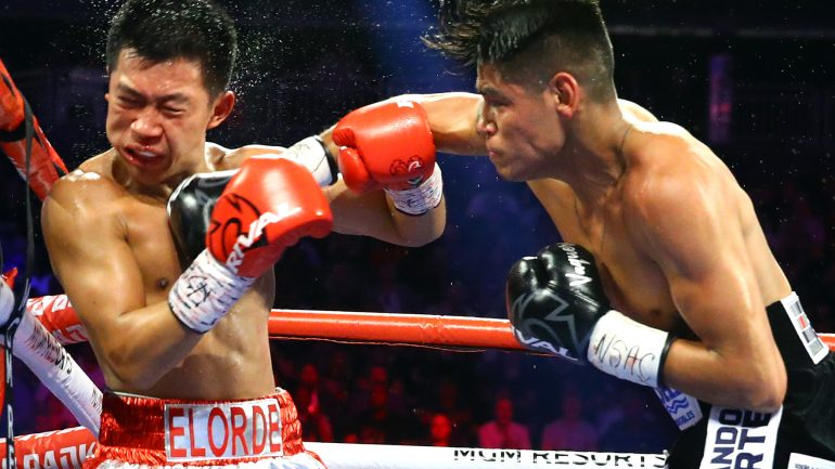 Emanuel Navarrete plows through overmatched Juan Miguel Elorde to retain junior feather belt