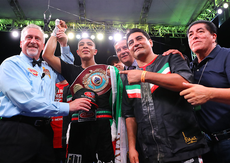 Jaime Munguia (second from left) celebrates his KO of Patrick Allotey with new trainer Erik Morales. Photo by Tom Hogan-Hoganphotos / Golden Boy Promotions