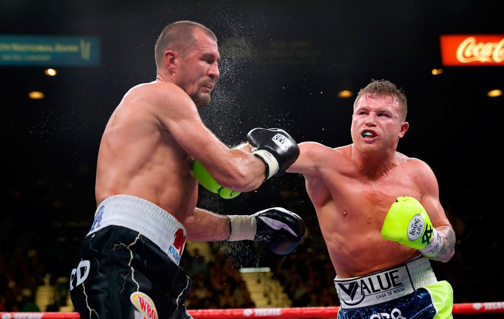 Canelo Alvarez (right) vs. Sergey Kovalev. Photo credit: Steve Marcus/Getty Images