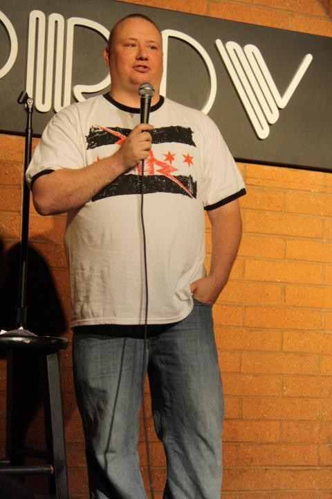 Boxing writer and standup comic Ernie Green on stage at the Tempe Improv in 2012. Photo credit: Ernie Green