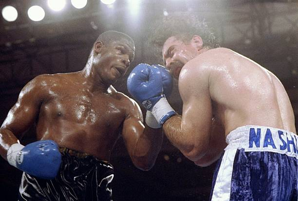 Riddick Bowe (left) trades blows with Pierre Coetzer.