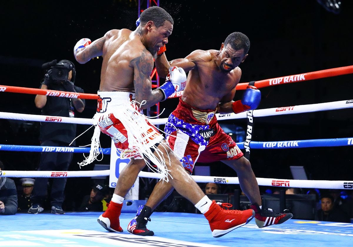 Jamel Herring (right) vs. Lamont Roach Jr. Photo by Mikey Williams/Top Rank