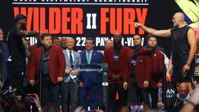 Deontay Wilder weighs a career-high 231; and Tyson Fury weighs in at 273