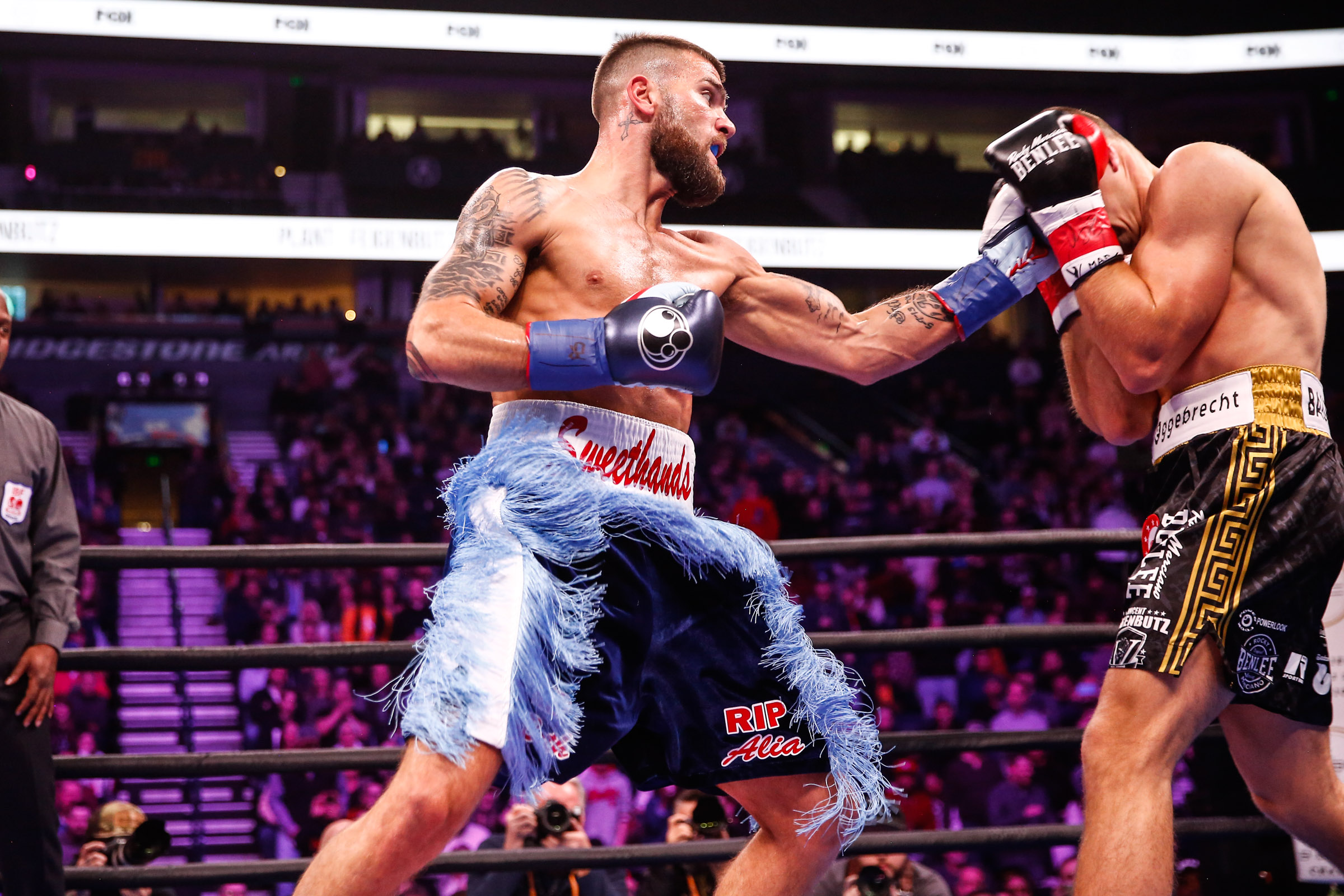 Caleb Plant (left) takes it to Vincent Feigenbutz. Photo by Stephanie Trapp/TGB Promotions