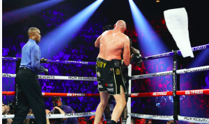 Mark Breland throws in the white towel, to save Deontay Wilder more punishment against Tyson Fury, Feb. 22, 2020.