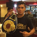 mike plania belt 150x150 - Thousands of miles from home, Mike Plania gets the call to fight