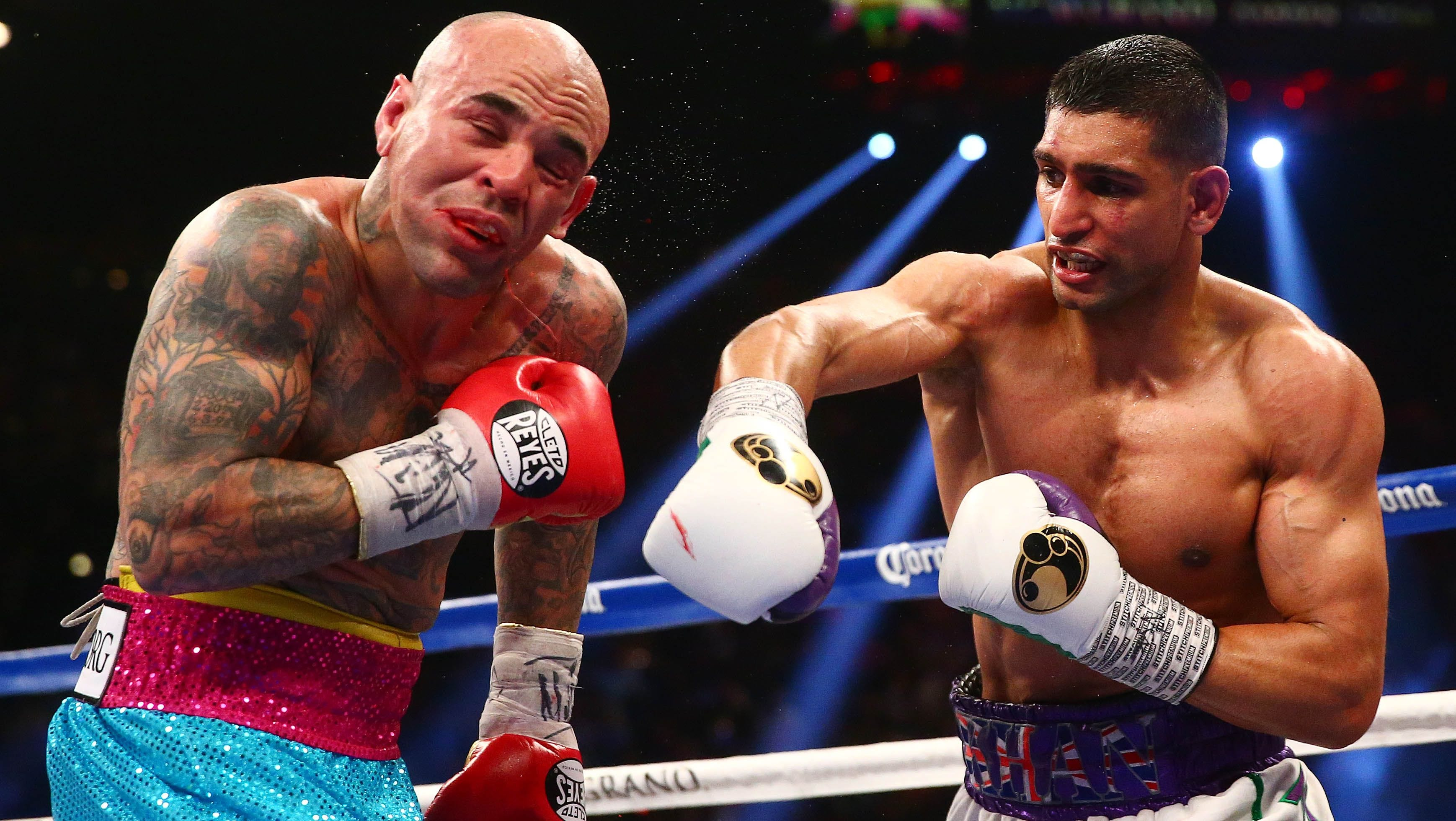 Amir Khan (right) vs. Luis Collazo. Photo credit: Mark J. Rebilas/USA TODAY Sports