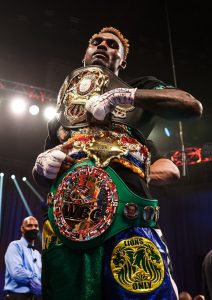 Charlo with 4 belts inc RING vertical 212x300 - Jermell Charlo stops Jeison Rosario in eight, unifies three belts, wins Ring Magazine 154-pound title