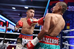 Julio Cesar Martinez (left) overwhelmed Moises Calleros. Photo by Ed Mulholland/Matchroom Boxing