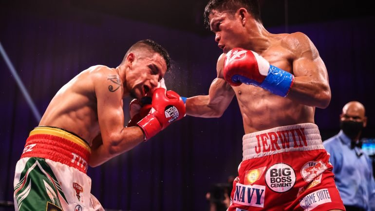 Jerwin Ancajas gets by the very game Jonathan Rodriguez for his ninth title defense