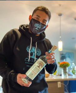 Teofimo Lopez holds a bottle of One With Life Organic Tequila, the product the concept of Lisa Elovich..