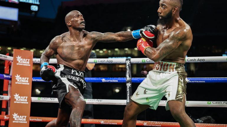 Ex-NFL star Chad Ochocinco gets knocked down but survives in boxing exhibition