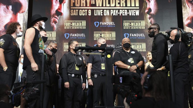 Fury and Wilder weigh in at their career heaviest in a tense private event