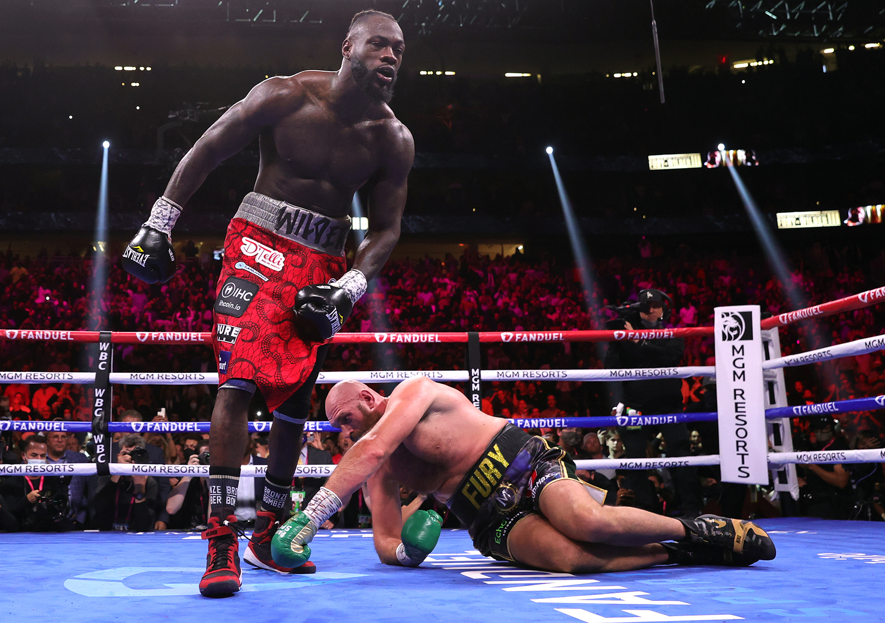 LAS VEGAS, NEVADA - OCTOBER 09: Deontay Wilder (L) knocks down Tyson Fury (R) during their fight for The Ring and WBC heavyweight titles at T-Mobile Arena on October 09, 2021 in Las Vegas, Nevada. (Photo by Mikey Williams/Top Rank Inc via Getty Images)