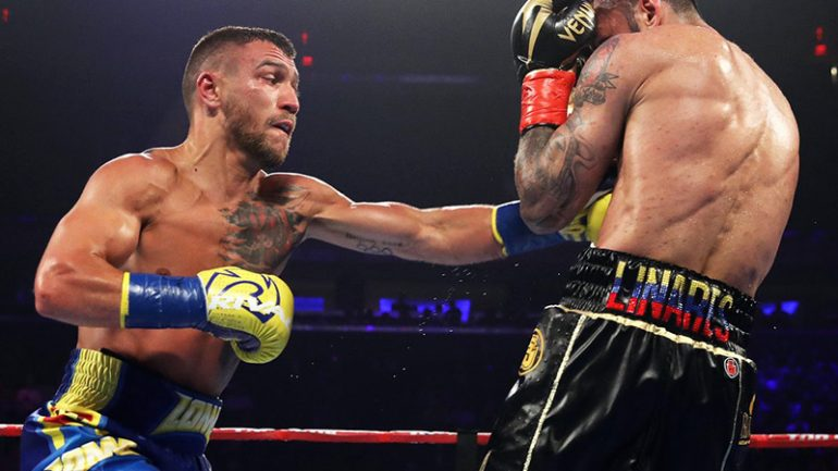 Vasiliy Lomachenko survives knockdown, stops Jorge Linares in 10th to win lightweight championship