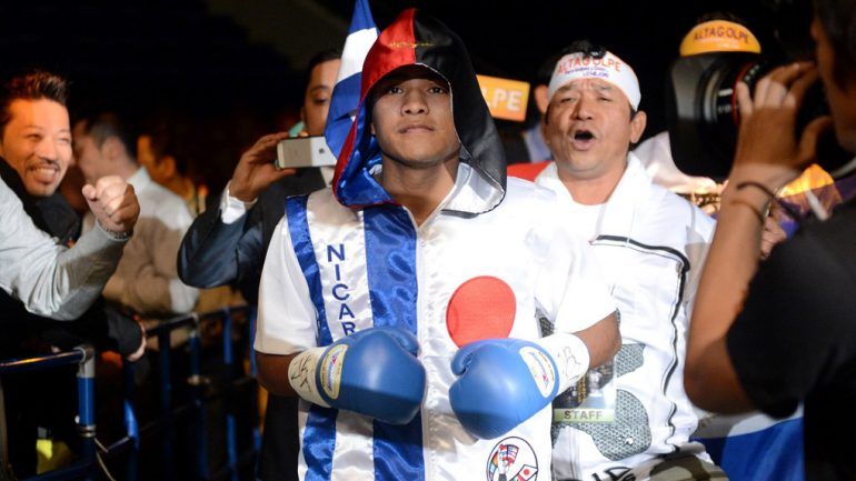 Chocolatito's trainer breathing through ventilator
